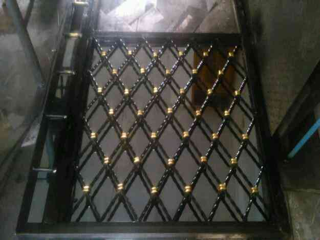 fabricamos puerta ventana cubrepuerta en metal hierro quito doplim