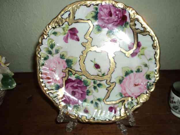 Vendo hermoso plato decorativo de porcelana