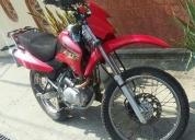 Una moto color roja. contactarse.