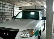 Excelente camioneta bt 50 con acciones y derechos