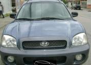 Vendo vehiculo utilitario hyundai santa fe.