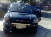 Hyundai tucson 2010 vendo o cambio con auto