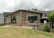 Vendo terreno con casa y chancheras en otavalo sector san pablo