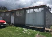 Vendo terreno con casa en el peaje de San Roque