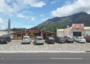 Vendo terreno con locales comerciales en atuntaqui