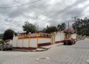 Vendo casa con locales comerciales en Otavalo