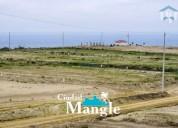 vendo terreno cerca al mar dentro de urbanizacion en montecristi manabi