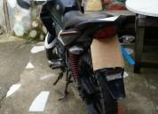 Vendo moto honda negra en cuenca