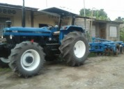Urgente vendo tractor marca new holland con arado trailers